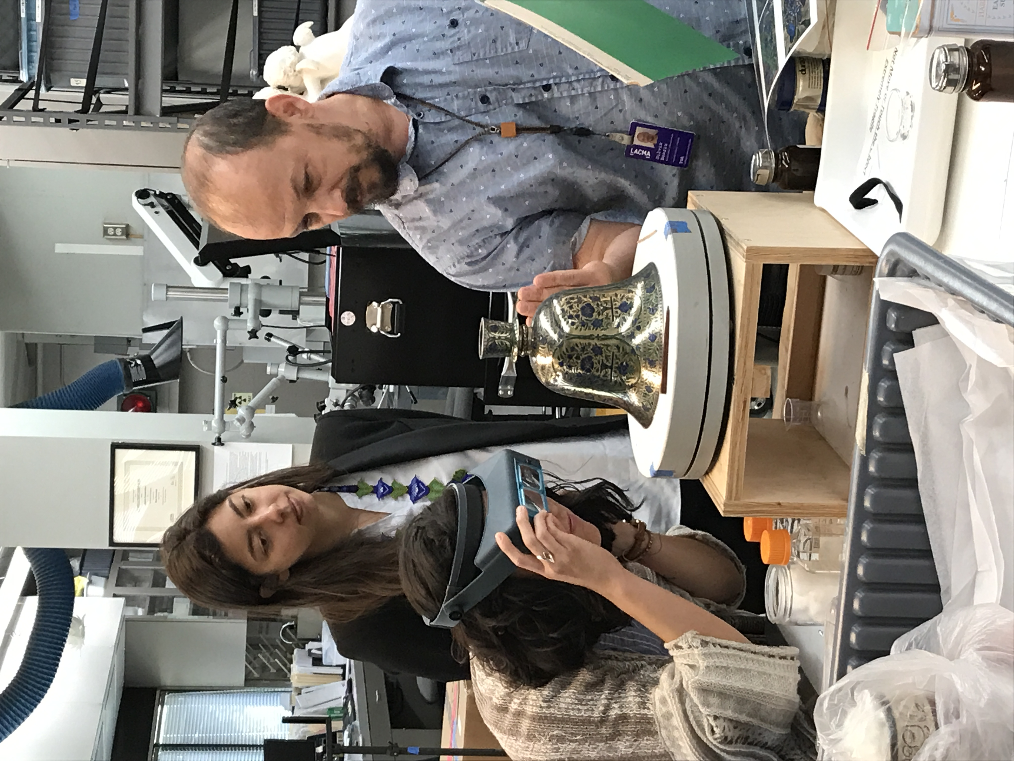 Aurora (center) in LACMA's Conservation Lab, with LACMA-ASU Fellow Ariana Enriquez (left) and LACMA Objects Conservator Silviu Boariu (right), photo courtesy of Hilary Walter