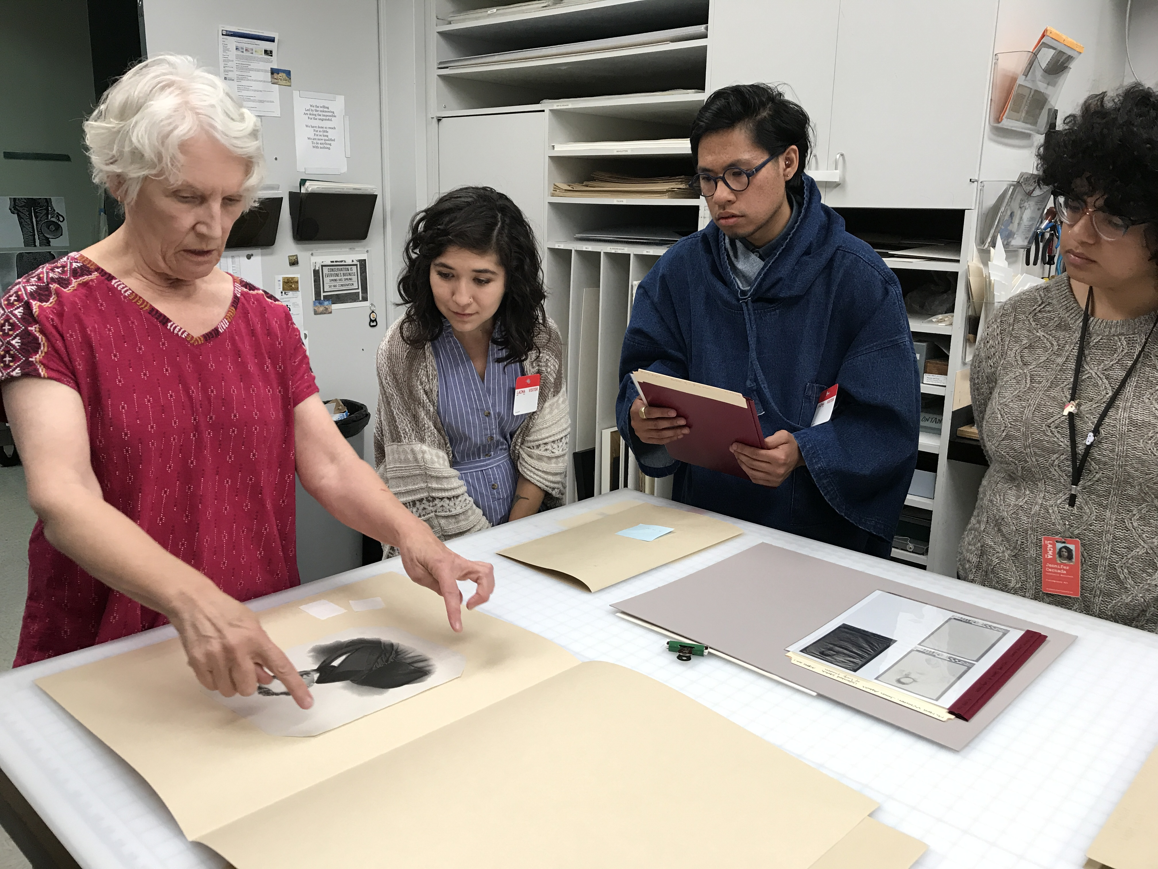 From left: Senior Paper Conservator Janice Schopfer and LACMA-ASU Fellows Ariana Enriquez, Matthew Miranda, and Jennifer Cernada in LACMA's Conservation Lab