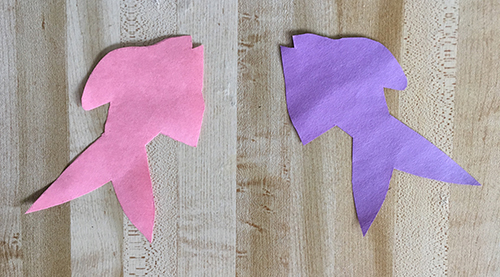 Pink and purple fish shapes cut out