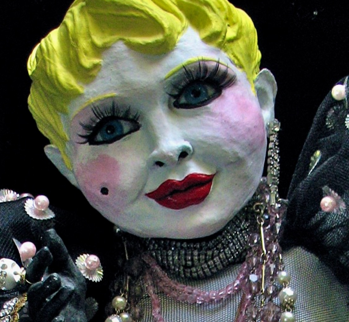 Close-up image of one of Greek Lankton's celebrity dolls