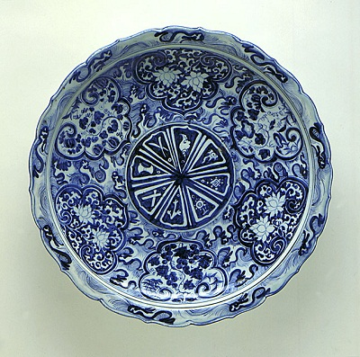 Foliated Platter (Pan) with the Eight Buddhist Symbols (Bajixiang), Flowers, and Waves, China, Jiangxi Province, Jingdezhen, late Yuan dynasty, circa 1340-1368, ceramic, porcelain, molded porcelain with blue painted decoration under clear glaze, gift of the Francis E. Fowler, Jr., Foundation and the Los Angeles County Fund, photo © 2012 Museum Associates/LACMA