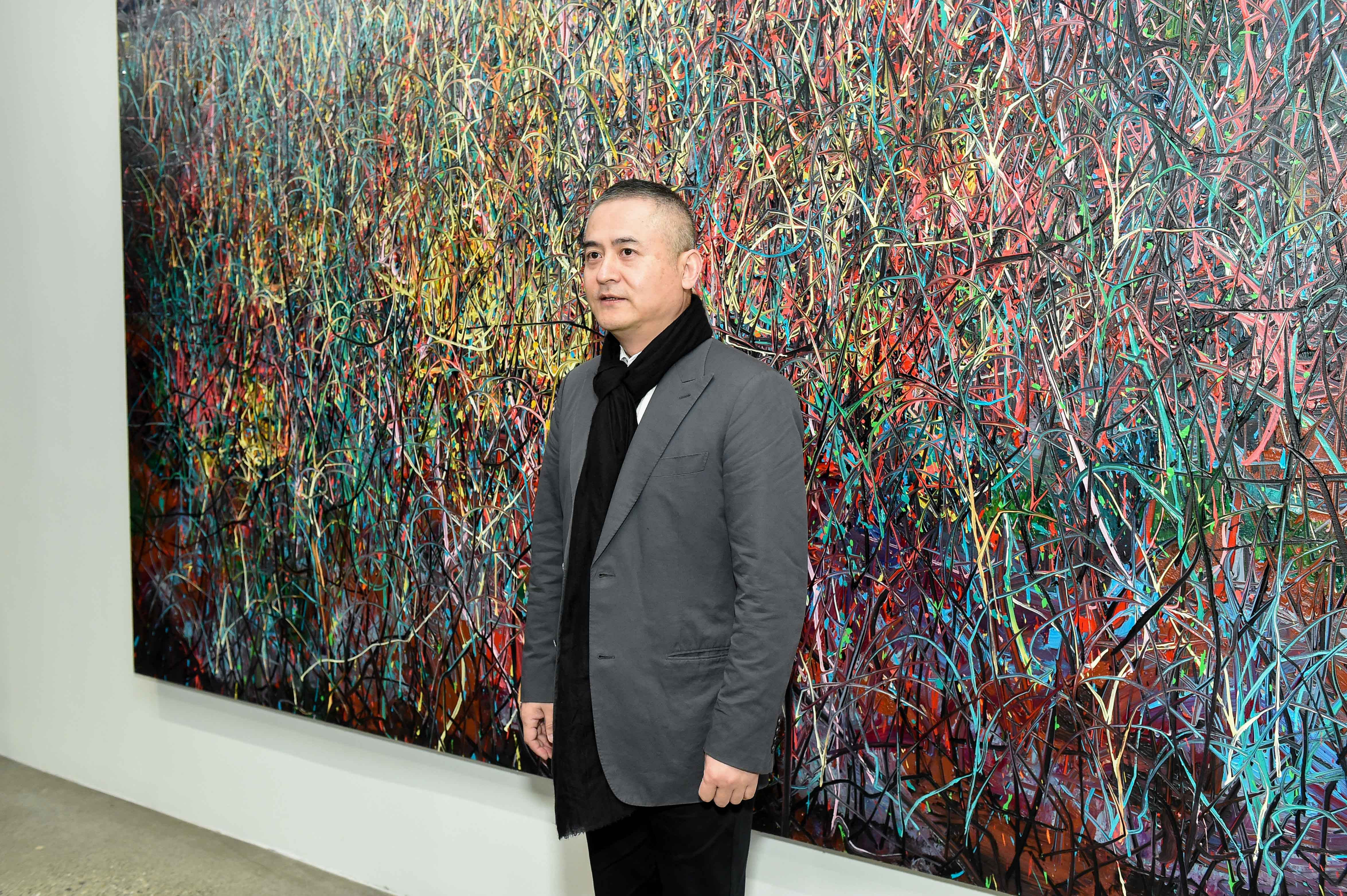 Artist Zeng Fanzhi in front of his painting, Untitled