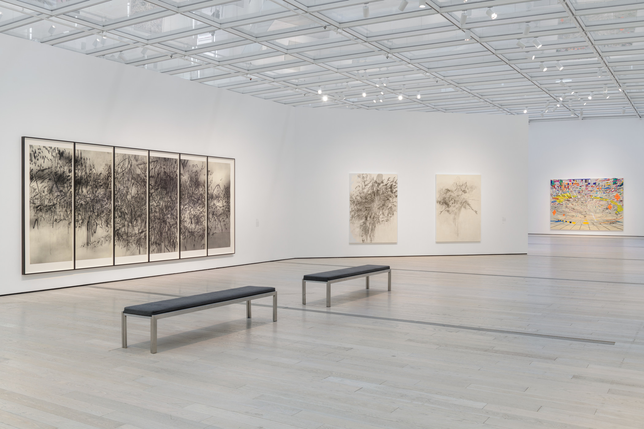 "Installation photograph, Julie Mehretu, Los Angeles County Museum of Art, November 3, 2019–May 17, 2020, art © Julie Mehretu, photo © Museum Associates/LACMA. From left: Epigraph, Damascus, 2016, Los Angeles County Museum of Art, gift of Kelvin and Hana Davis through the 2018 Collectors Committee; Being Higher II, 2013, Collection of Susan & Larry Marx; courtesy Neal Meltzer Fine Art, New York; Being Higher I, 2013, Tiago Ltd: ""The Tiqui Atencio Collection""; Stadia II, 2004, Carnegie Museum of Art, Pittsburgh, gift of Jeanne Greenberg Rohatyn and Nicolas Rohatyn and A. W. Mellon Acquisition Endowment Fund 2004.50"