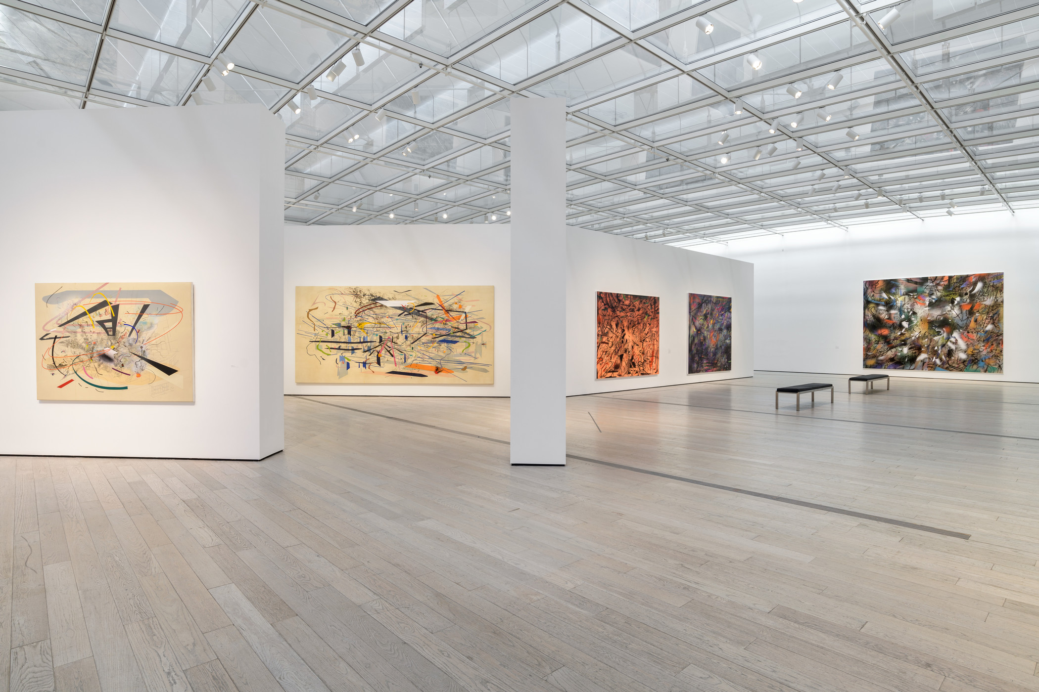Installation photograph, Julie Mehretu, Los Angeles County Museum of Art, November 3, 2019–May 17, 2020, art © Julie Mehretu, photo © Museum Associates/LACMA. From left: Untitled 2, 2001, private collection, courtesy of Salon 94, New York; Retopistics: A Renegade Excavation, 2001, Crystal Bridges Museum of American Art, Bentonville, AR; 2013.28; Hineni (E. 3:4), 2018, Don de George Economou, 2019, Centre Pompidou, Paris, Musée national d'art moderne/Centre de création industrielle; Sun Ship (J.C.), 2018, Pinault Collection; Haka (and Riot), 2019, courtesy of the artist and Marian Goodman Gallery, New York