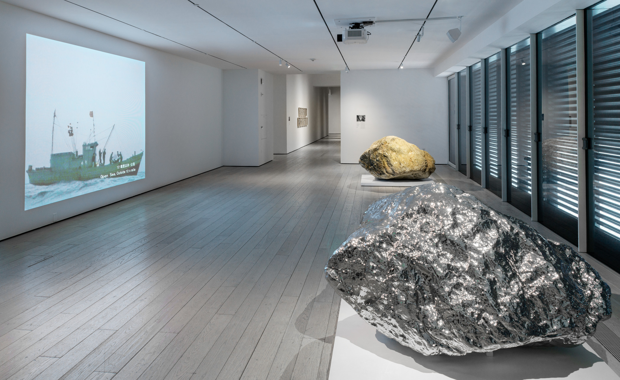 Installation photograph, featuring Zhan Wang's Beyond 12 Nautical Miles Floating Rock Drifts on the Open Sea (2000) and Gold Mountain (2007), in the exhibition The Allure of Matter: Material Art from China, at the Los Angeles County Museum of Art, June 2, 2019–January 5, 2020, © Zhan Wang, photo © Museum Associates/LACMA