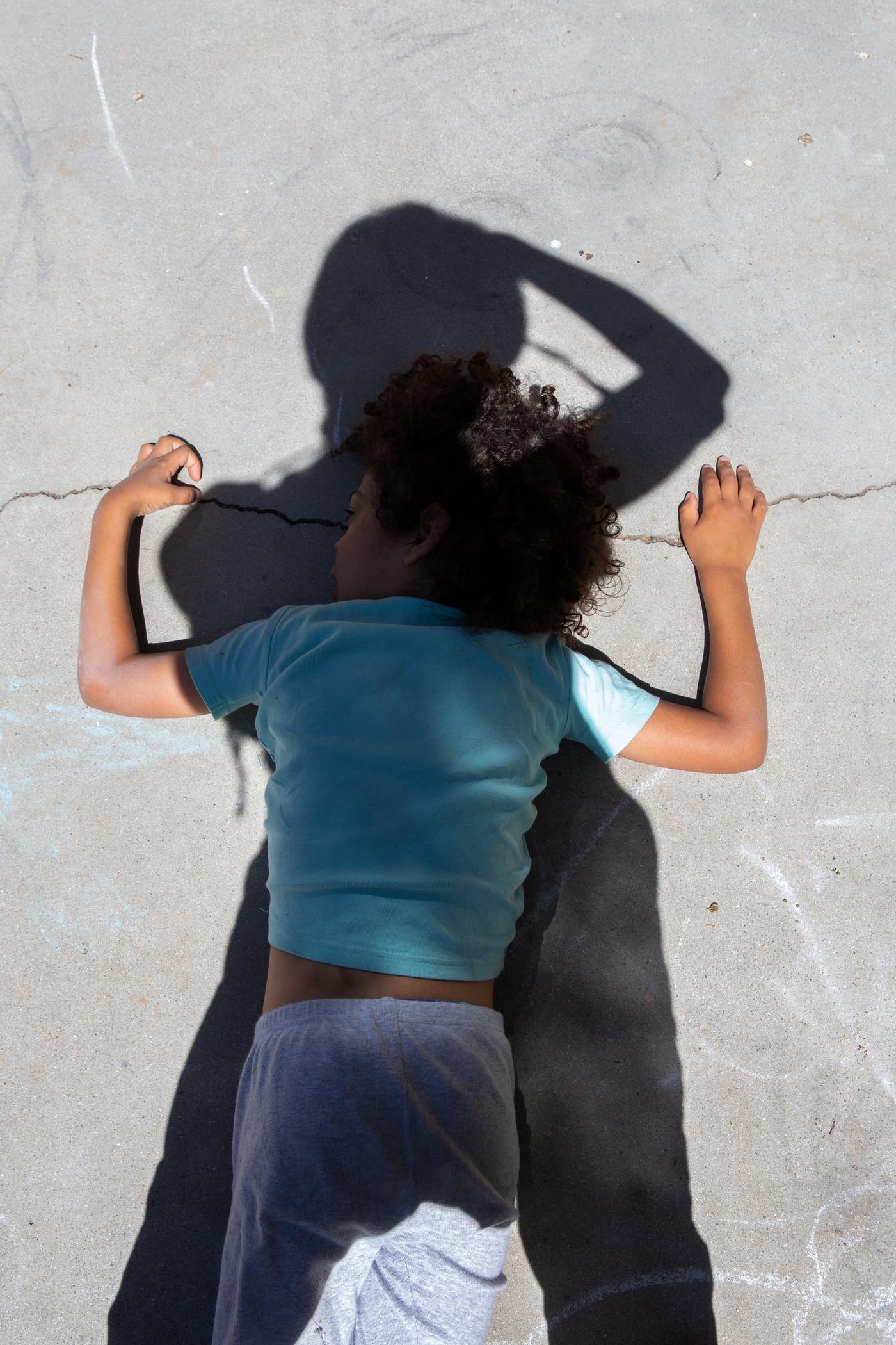 Photo of child on ground