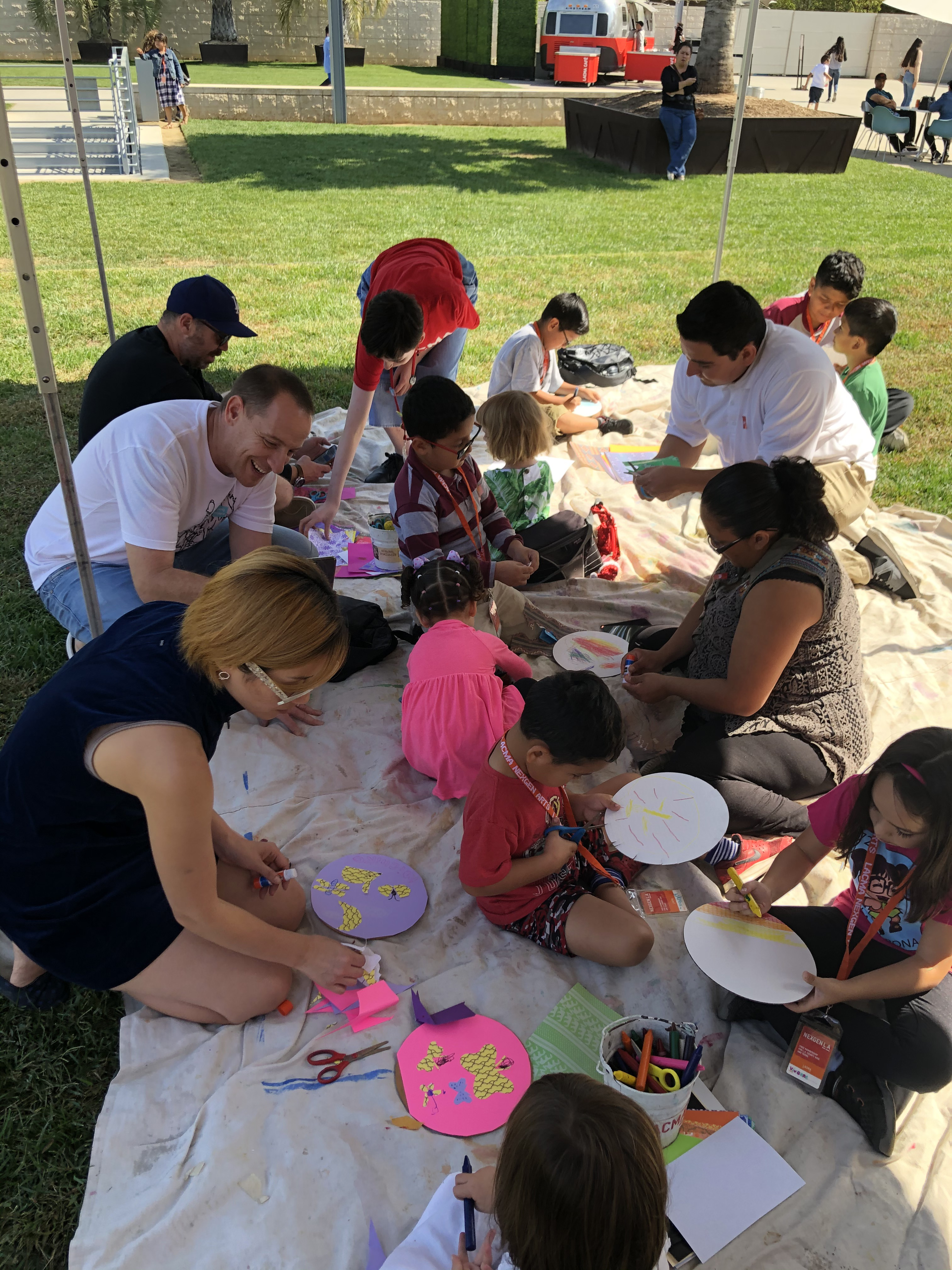 Toddler artists creating collages in artist Sofia Gutierrez's workshop