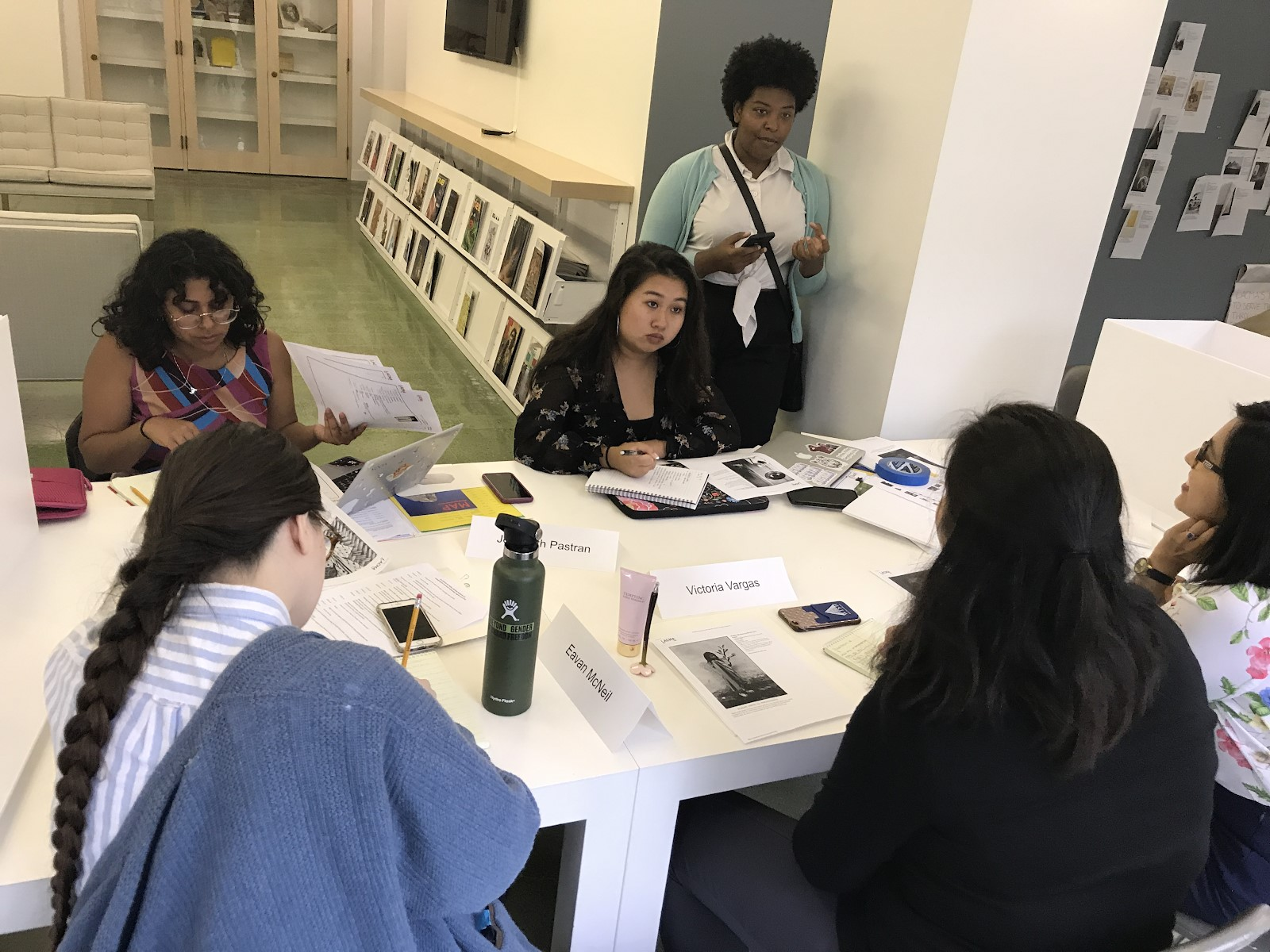 The 2019 Mellon Summer Academy students: Jenebrith Pastran, Emily Le, JaBrea Patterson-West (advisor), Melissa San Miguel, Victoria Vargas, and Eavan McNeil discussing their selected photographs, photo courtesy Hilary Walter