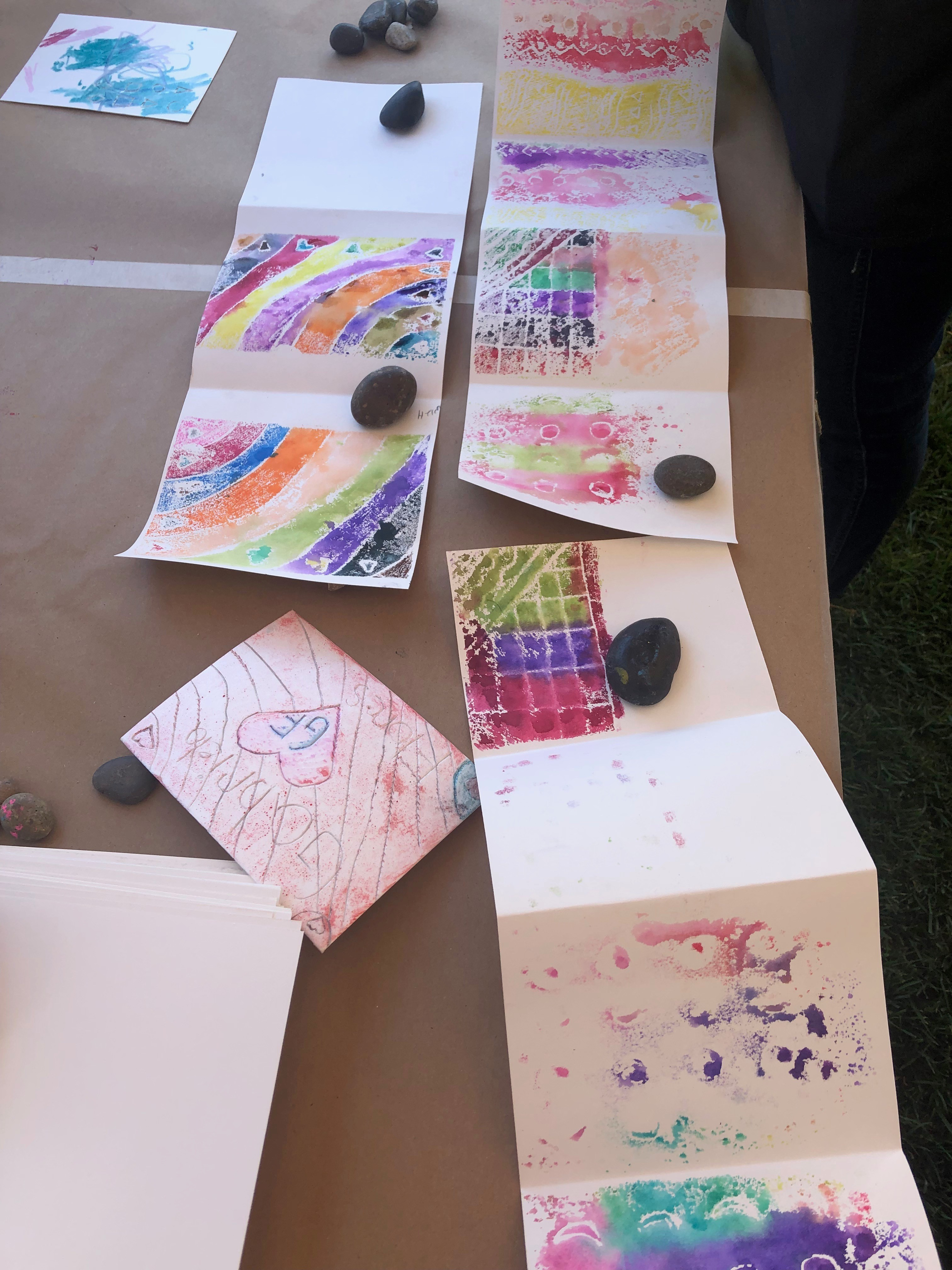 Families decorate art books at Andell Family Sundays
