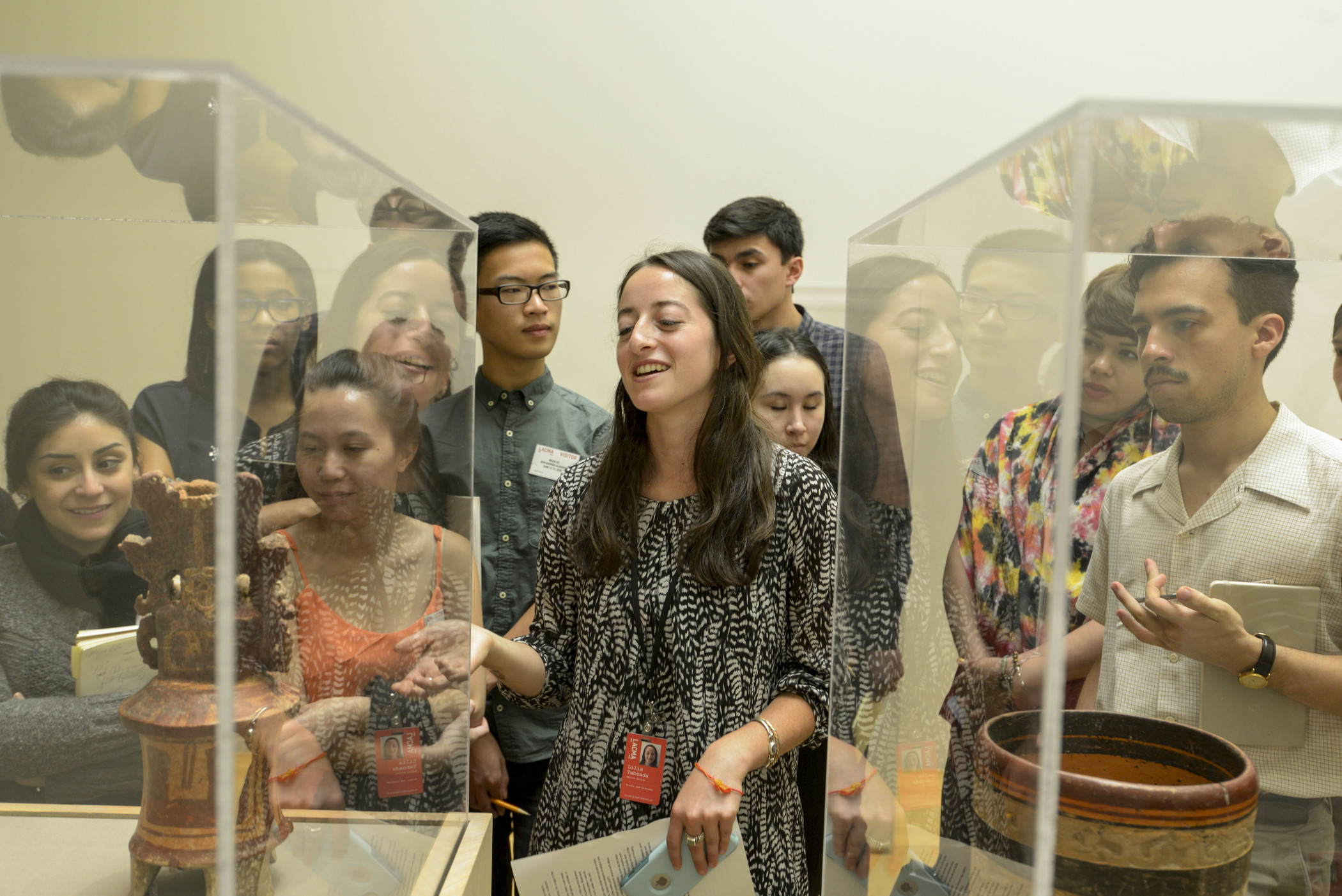 Mellon Academy participants looking at objects in exhibition