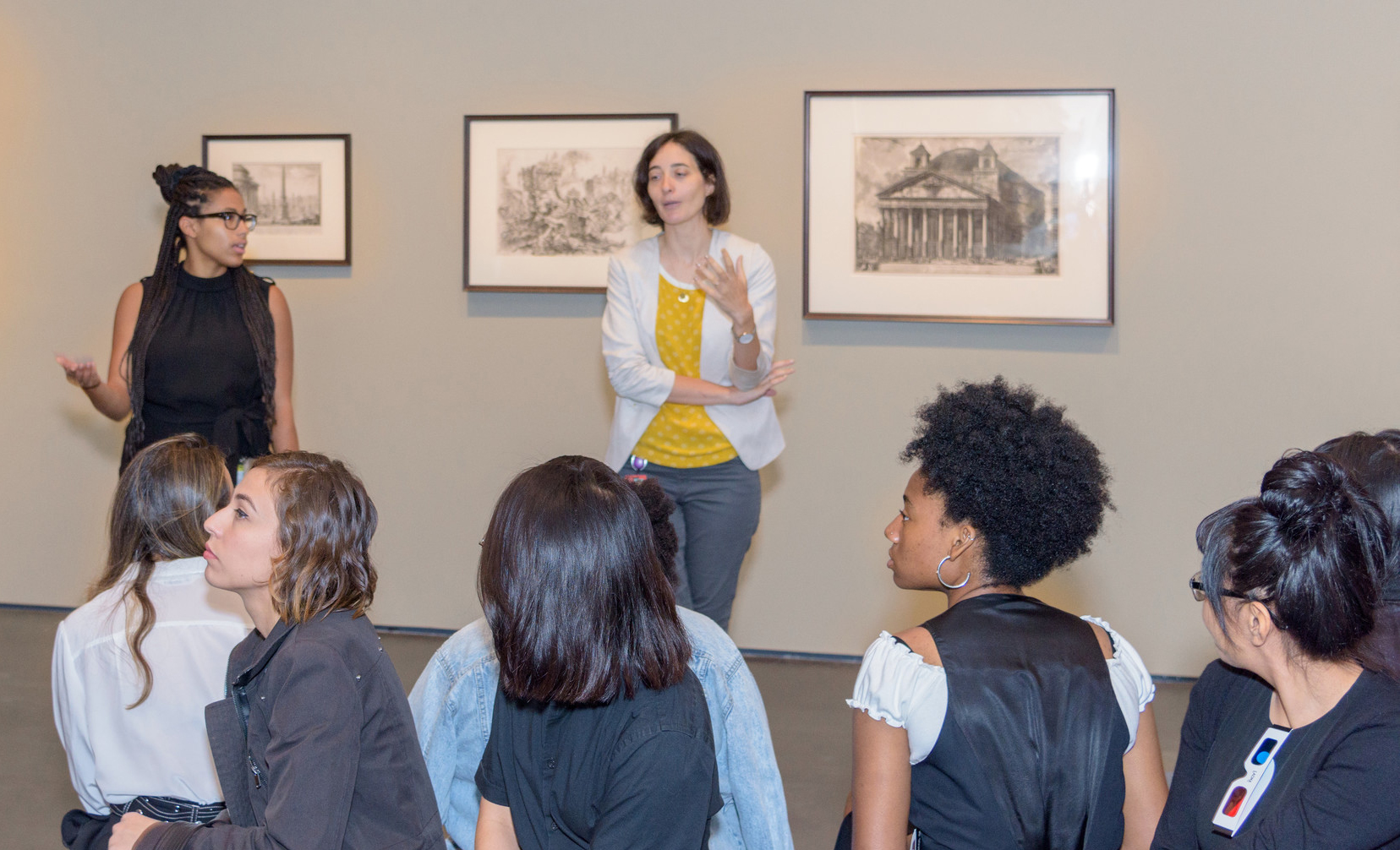 Mellon Academy participants sitting listening to curator Leah Lehmbeck