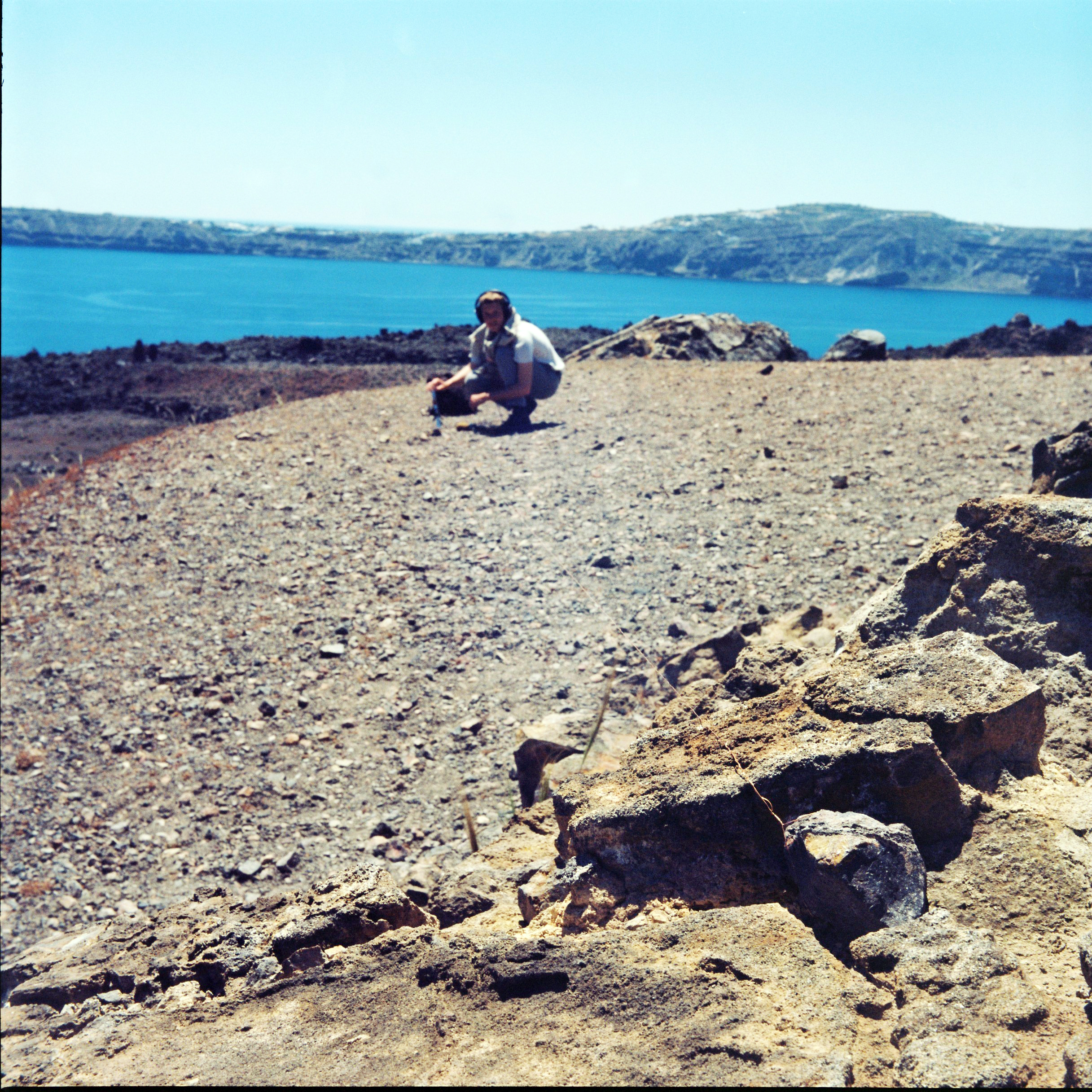 Tamm recording aeolian winds on Nea Kameni (Santorini's volcanic crater) for Tympanic Tether; photograph by Hermione Spriggs, 2015