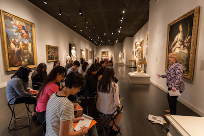 The Andrew W. Mellon Summer Academy participants in the European Painting gallery with Education Director of Adult Programs, Mary Lenihan. Photo © Museum Associates/ LACMA