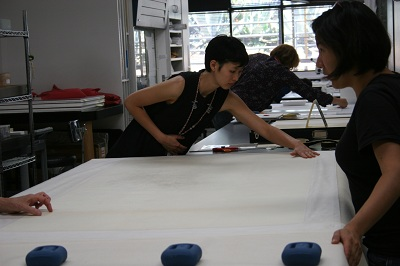 Pre-program Intern, Jacklyn Chi, preparing the print for drying.