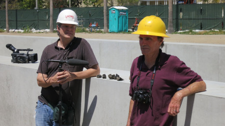 Doug Pray and Michael Heizer on construction site at LACMA for the sculpture Levitated Mass