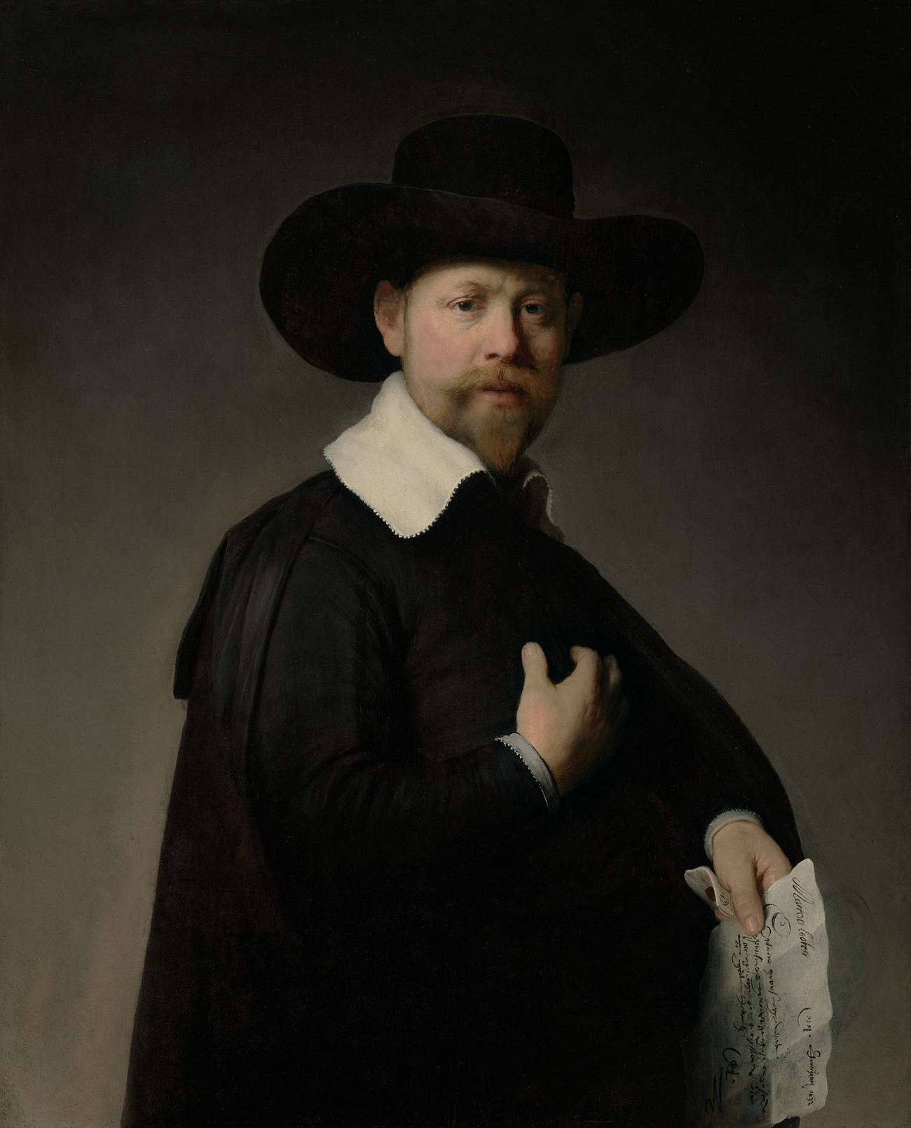 Portrait of a man with a pointy bears and small mustache. He's wearing a wide-brimmed hat, wide white collar, and black cloak over a black jacket. He holds a letter in his left hand