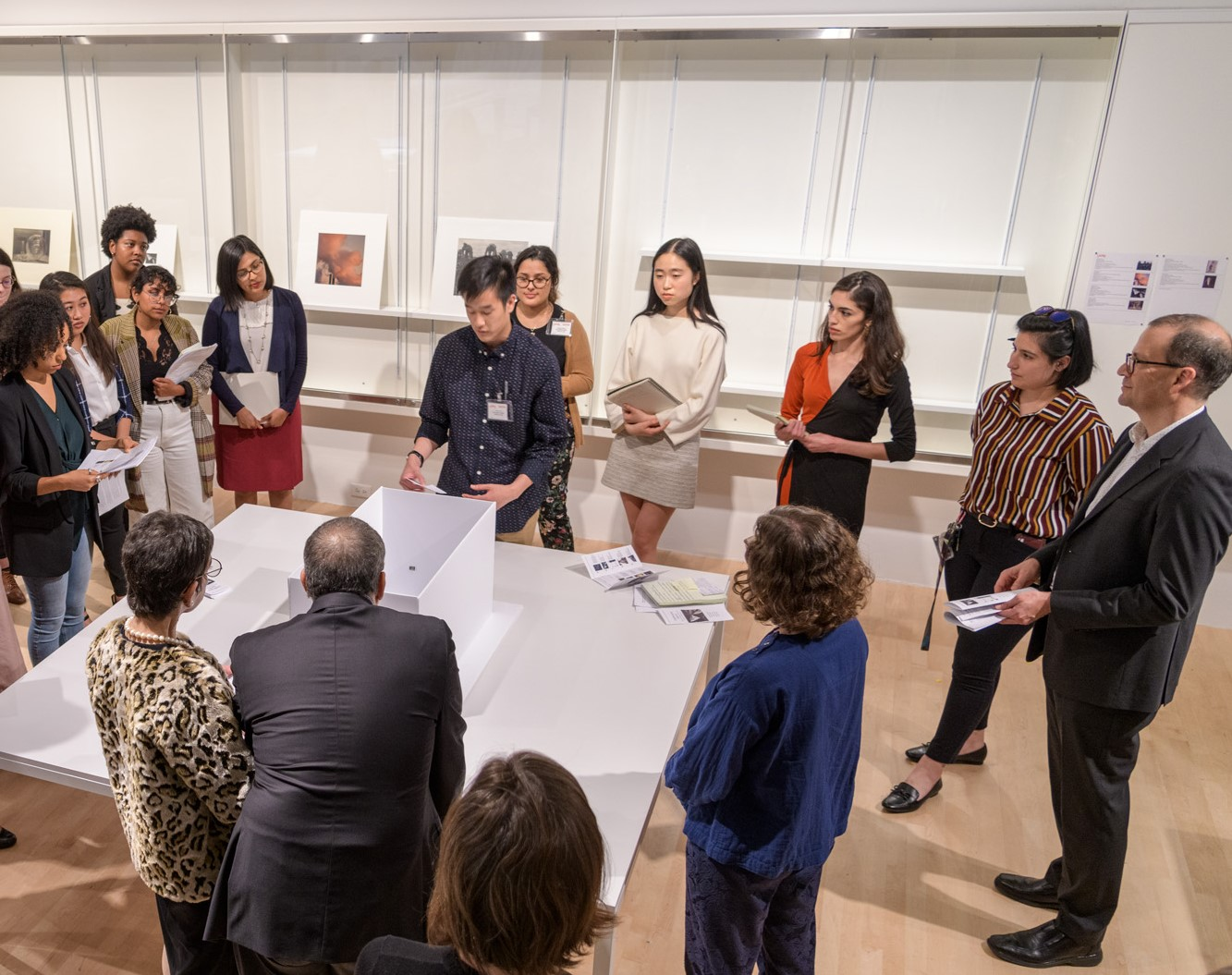 The 2019 Mellon Summer Academy group presenting their exhibition idea to the museum's director, the donor's family, and LACMA staff, photo © Museum Associates/LACMA