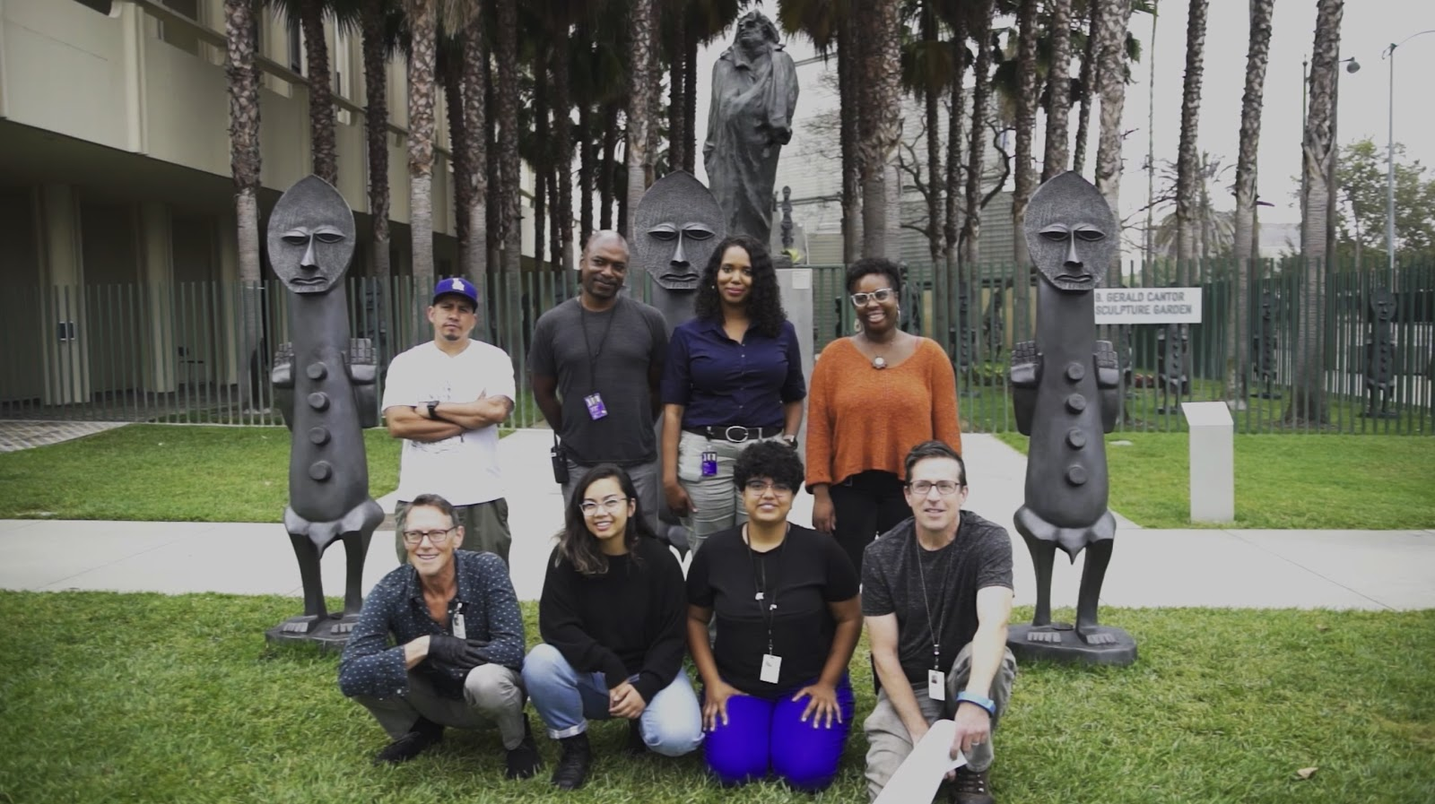 "Top row, left to right: Senior Art Preparator Shorty, Senior Art Preparator Michael Price, Assistant Registrar Dawn Turner, Art Preparator I Kadejah ""Dejah"" Spraggs; Bottom row, left to right: Art Preparator II David Foster, Art Preparator I (then DAP Apprentice) Jasmine Tibayan, former curatorial assistant Jennifer Cernada, and Senior Art Preparator Thomas Duffy. Installation of the Zak Ové 2019 installation The Invisible Man and the Masque of Blackness, art © Zak Ové, photo by Senior Art Preparator Giorgio Carlevaro"