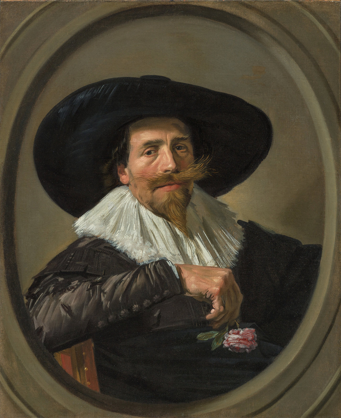 Portrait of man with a pointy beard and wide, bushy mustache. He wears a wide-brimed hat, white ruff, and buttoned black jacket and is holding a pink rose in his right hand, which is propped on the back of his chair