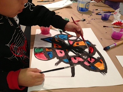 Young artists at work at Charles White Elementary School