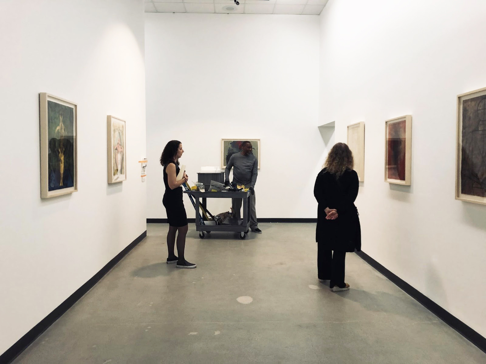 Installation photograph of Rufino Tamayo: Innovation and Experimentation, Los Angeles County Museum of Art at Charles White Elementary School Gallery, December 21, 2019–July 11, 2020, art © 2020 Tamayo Heirs/Mexico/Artists Rights Society (ARS), New York. From left to right: Rachel Kaplan, assistant curator of Latin American Art; Cedric Adams, senior art preparator; Ilona Katzew, curator and department head of Latin American Art, photo: Deliasofia Zacarias