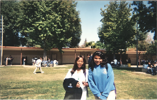 Polly standing with a friend in Middle School, photo courtesy of Polly Dela Rosa