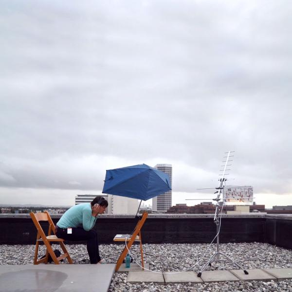 Kata Kovács tracking satellite signals on the roof at LACMA, August 2017, © Kovács/O'Doherty