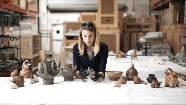 Julia Burtenshaw, LACMA's assistant curator for the Art of the Ancient Americas department studying Colombian artifacts from LACMA's collection.
