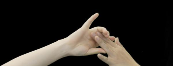 image of hands against a black background