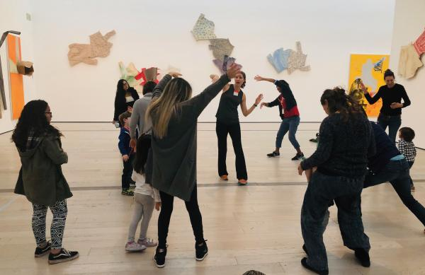 People dancing in front of Robert Rauschenberg's The 1/4 Mile or 2 Furlong Piece