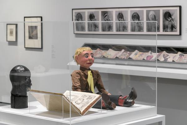 Installation photograph showing gallery view of the exhibition NOT I: Throwing Voices (1500 BCE–2020 CE), including a ventriloquist dummy in a display case
