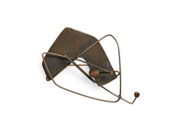 Abstract metal brooch
