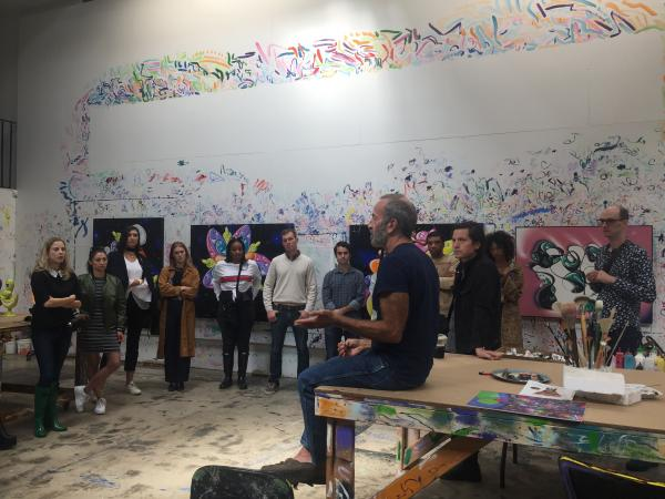 Avant-Garde members attending a studio visit with artist Kenny Scharf