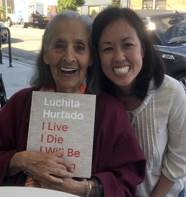 Luchita Hurtado and curator Jennifer King with the catalogue for I Live I Die I Will Be Reborn