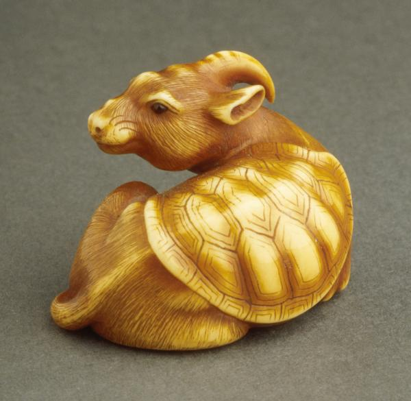 composite animal laying down—tortoise shell on back, one horn, face of a rat