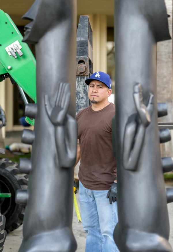 "Gerardo ""Shorty"" Arcienaga pictured at the deinstall of Zak Ové's 2019 installation, The Invisible Man and the Masque of Blackness, art © Zak Ové, photo by Senior Art Preparator Giorgio Carvelaro"