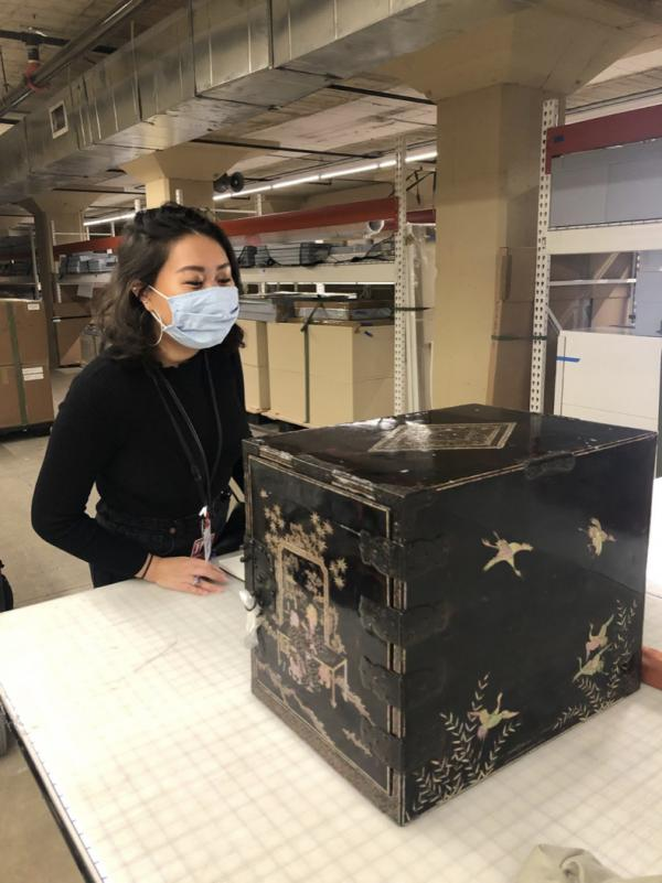 Young woman in front of Japanese lacquer chest
