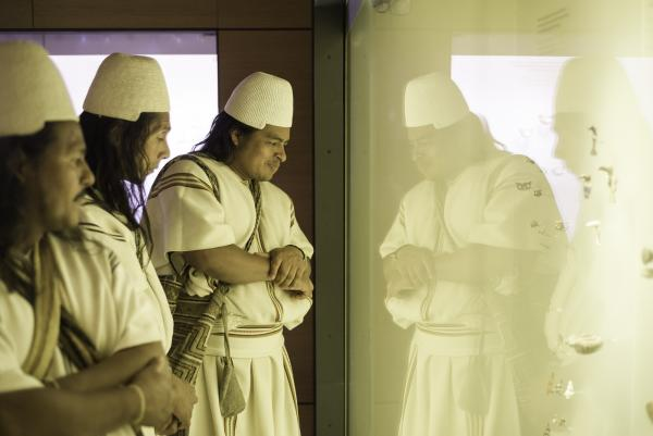 Members of the Arhuaco community looking at Tairona objects in the Museo del Oro Santa Marta