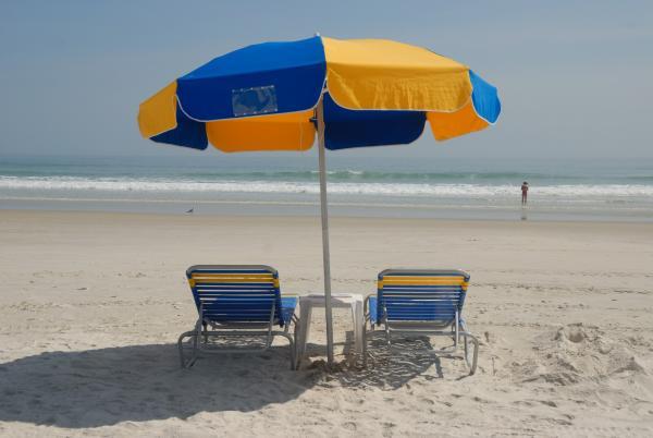 Beach Chairs and Umbrella, photograph by Paul Brennan (CC0)