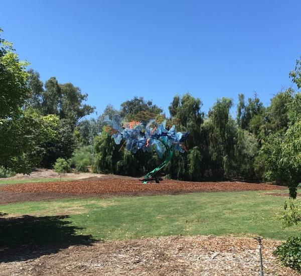 Installation photograph, featuring Nancy Graves's Trace (1981), in the exhibition HIDE AND SEEK—Art Meets Nature, at the South Coast Botanic Garden