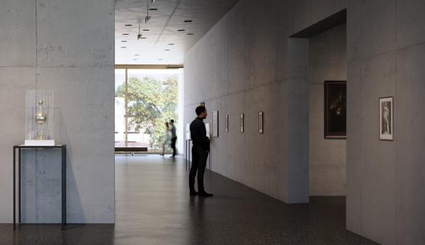 A person views art on the walls in a gallery with the outdoors visible in the background