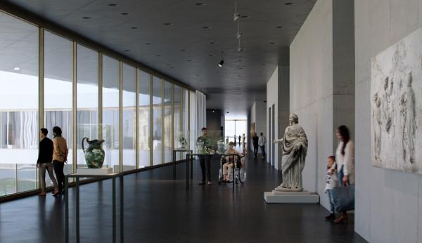 Gallery view with sculptures and floor-to-ceiling windows