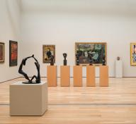 Sculptures and paintings in a gallery