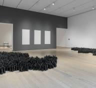 Installation photograph, featuring Liu Jianhua's Black Flame (2016–17) and Blank Paper (2009–12), in the exhibition The Allure of Matter: Material Art from China, at the Los Angeles County Museum of Art