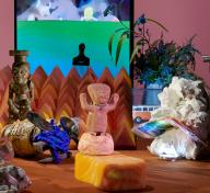 Diorama with sculptures, objects, and video