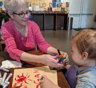 Tracy Newman and grandson Logan in the Boone Children's Gallery, photo credit: Liza Cranis