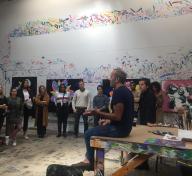 Avant-Garde members attending a studio visit with artist Kenny Scharf