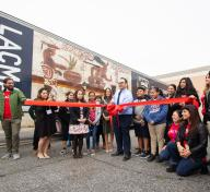 Principal Cuevas of Bell Gardens Intermediate cuts the ribbon on March 11, 2019, photo by Stephenie Pashkowsky