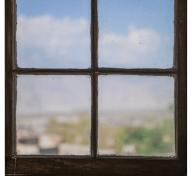 photograph of a window, looking out toward a blue sky