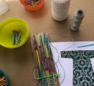 Weaving project during artist Julianna Ostrovsky's workshop Fiber Painting Ikat Style at Andell Family Sundays